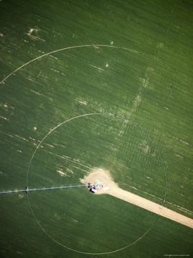 Modern Pivot Farming Along the Okavango River, Namibia by Michael Fay