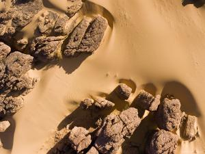 Sand is Creeping into the Rock Outcrops Northwest of Fada, Chad by Michael Fay