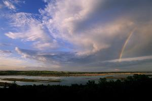 A Rainbow and Clouds over Lewis and Clark Lake by Michael Forsberg