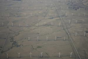Aerial View of a Wind Farm with Row Upon Row of Wind Turbines by Michael Forsberg