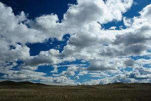 Rolling Hills with White Clouds and Blue Sky by Michael Forsberg