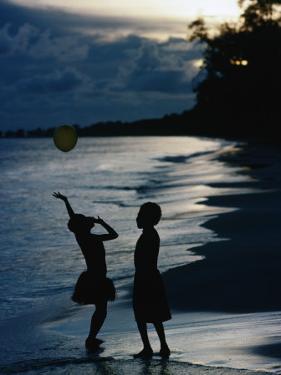 Young Girls Playing with a Balloon on Kiriwina Island, Kiriwina Island, Milne Bay, Papua New Guinea by Michael Gebicki