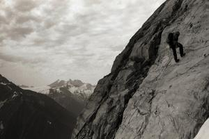 A Climber Rappels Down a Rock Face Near Rogers Pass by Michael Hanson