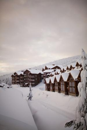 Snow Covers Apartments on a Cloudy Morning at the Big White Ski Resort by Michael Hanson