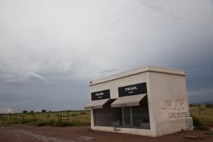 Prada Marfa, a permanent sculpture by artists, Elmgreen and Dragset. by Michael & Jennifer Lewis
