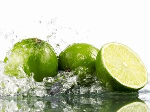 Limes with Splashing Water by Michael L?ffler