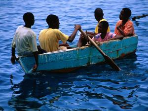 Boys Rowing Boat, Soufriere, Dominica by Michael Lawrence