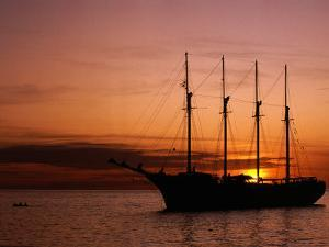 Tall Ship at Anchor South of Rouseau, West Coast, Roseau, Dominica by Michael Lawrence