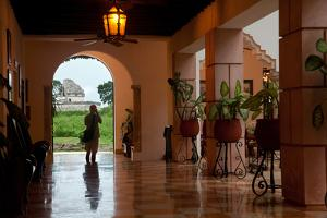 A Tourist Photographs Chichen Itza's Observatory from the Hotel Mayaland by Michael Lewis