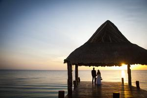 Newlyweds Watch the Sunset after their Beach Wedding on the West Coast of Cozumel Island by Michael Lewis