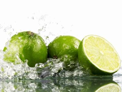 Limes with Splashing Water by Michael Löffler