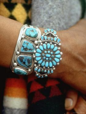 Close Up of Wrist Modeling Turquoise Bracelets Made by Native Americans by Michael Mauney