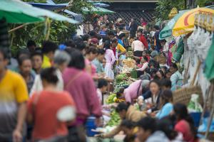 A Bustling Street Market in Prabang by Michael Melford