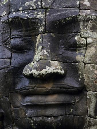 A Carved Stone Face at Bayon Temple by Michael Melford