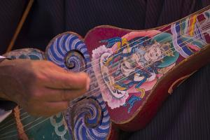 A Close Up of a Traditional Dranyen, a Lute Like Instrument by Michael Melford