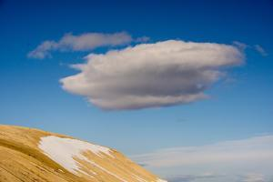 A Cloud in a Blue Sky Floats Above Palanderbukta by Michael Melford