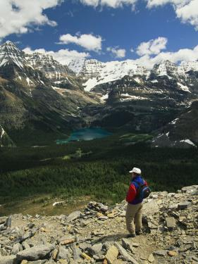 A Hiker Enjoys the View of Obabin Prospect in Yoho National Park by Michael Melford