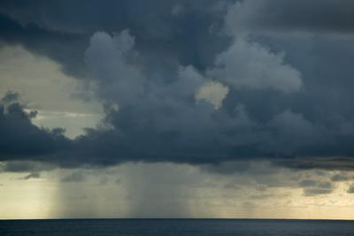 A Rain Storm at Sunrise on the Pacific Ocean Off Corcovado National Park by Michael Melford