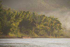 A Traditional Cruise Boat on the Mekong River by Michael Melford