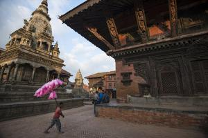A Young Cotton Candy Seller Walking Through Durbar Square by Michael Melford