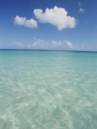 Aquamarine Water Bleeds into Blue Skies in This Tropical View by Michael Melford