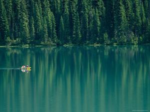 Canoeing on Still Water of Yoho National Parks Emerald Lake by Michael Melford