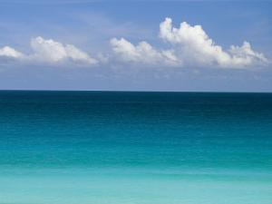 Clear Blue Water and White Puffy Clouds Along the Beach at Cancun by Michael Melford