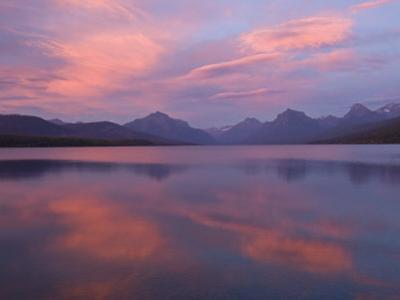 Fall sunset on Lake McDonald looking to the high peaks to the east. by Michael Melford