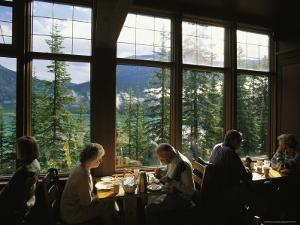 Guests Enjoy a Meal in the Emerald Lake Lodge Dining Room by Michael Melford