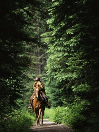Horseback Riding on an Emerald Lake Lodge Bridle Trail by Michael Melford