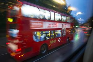 In 2013, a Double-Decker City Bus Speeds Through London at Dawn by Michael Melford