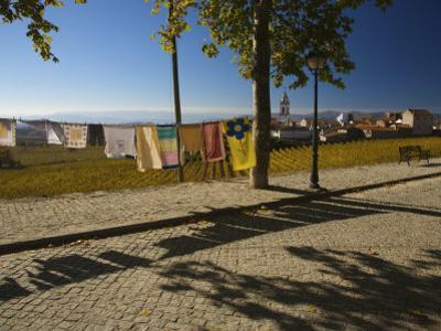 Laundry Hung Out to Dry Above the Hillside Town of Favaios by Michael Melford