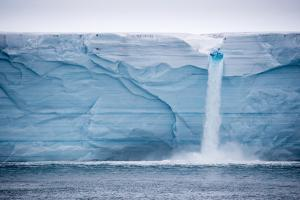 Meltwater Pours over an Ice Cliff from the Surface of the Nordaustlandet Ice Cap by Michael Melford
