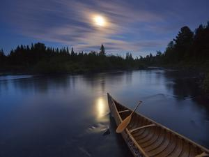 Moonlight Bathes a Birchbark Canoe on Maine's Allagash River by Michael Melford
