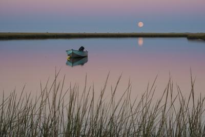 Moonrise at Sunset and a Lone Boat in Salt Pond Bay, Eastham, Cape Cod, Massachusetts by Michael Melford