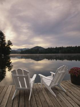 Pair of Adirondack Chairs on a Dock at the Mirror Lake Inn by Michael Melford