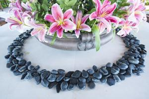 Polished Black Stones Ring a Bouquet of Pink Orchids by Michael Melford