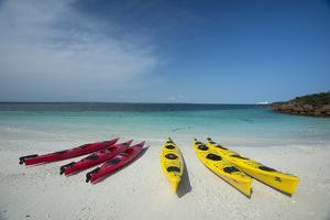 Sea Kayaks Resting on the Beach on Isla Iguana by Michael Melford