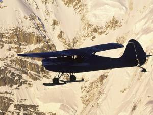 Ski Plane from Talkeetna Flies Past Mount Denali by Michael Melford