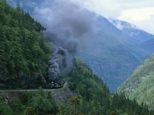 Smoke Billows from a Train on White Pass and Yukon Route Railroad by Michael Melford