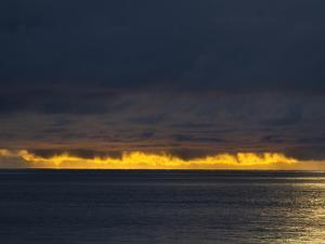 Sunlight Hits Clouds over the Pacific Ocean in Panama by Michael Melford