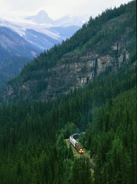 The Canada Pacific Train Travels Through Kicking Horse Pass by Michael Melford