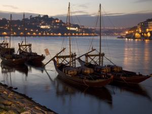 Wine Barrels on Boats in Oporto at Dusk by Michael Melford