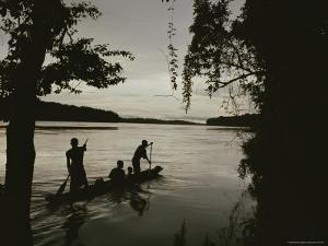 A Family in a Pirogue Canoe Travels up the Sangha River by Michael Nichols
