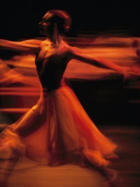 Portrait of a Ballet Dancer Bathed in Red Light, Nairobi, Kenya by Michael Nichols