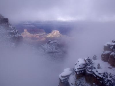 Winter Mist over a Snow-Blanketed Grand Canyon Landscape by Michael Nichols