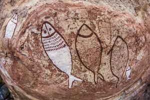 Aboriginal Wandjina Cave Artwork in Sandstone Caves at Raft Point, Kimberley, Western Australia by Michael Nolan