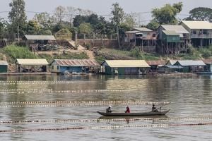 Cham People Using a Dai Fishing System for Trei Real Fish on the Tonle Sap River, Cambodia by Michael Nolan