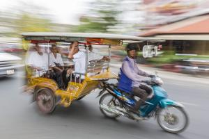 Motion Blur Image of a Tuk-Tuk in the Capital City of Phnom Penh by Michael Nolan