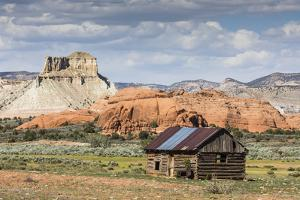 Red rock sandstone and old cabin just outside Kodachrome Basin State Park, Utah, United States of A by Michael Nolan